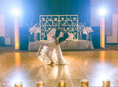 Indian bride and groom dancing at the reception