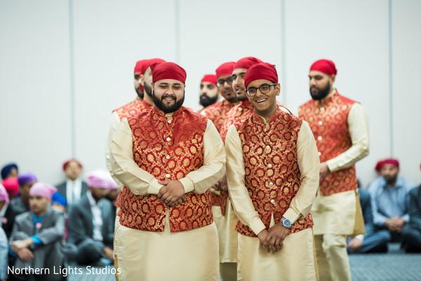 Joyful Indian groomsmen entrance to ceremony.