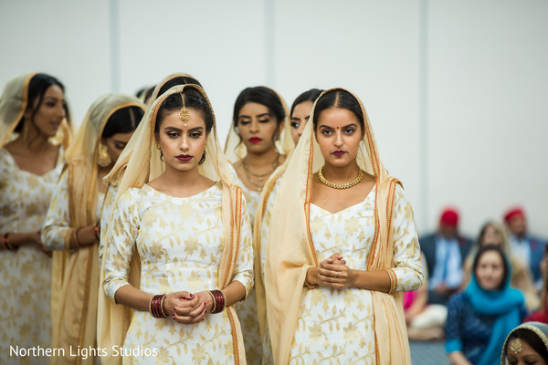 Lovely Indian bridesmaids entrance to ceremony.