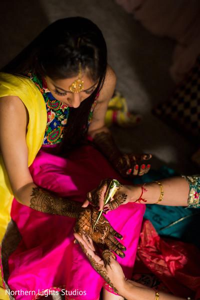 Mehndi artist at work being done.