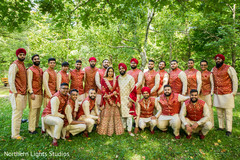 Glamorous Indian bride and groom portrait with groomsmen.