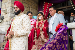 Special moment of Indian bride saying good by to her family.
