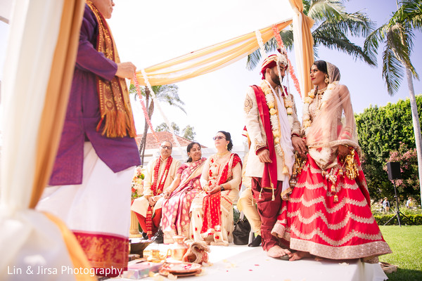 Indian groom receiving the Maharani under the mandap