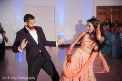 Indian bride and groom performing at the reception
