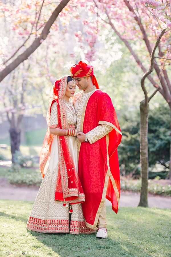 Indian bride and groom outdoors for pictures