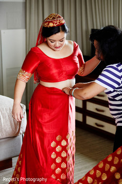 Maharani being assisted with her lengha