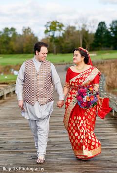 Maharani and Raja holding hands outdoors