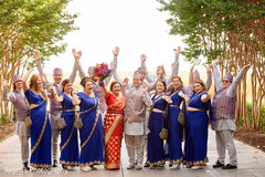Indian bride and groom posing with bridesmaids and groomsmen