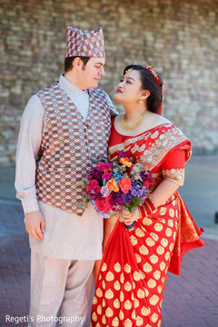 Tender moment between the Indian bride and groom