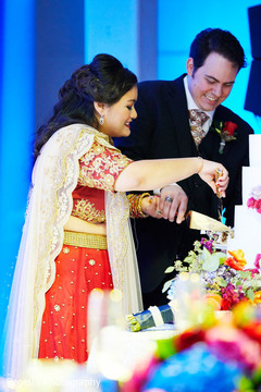 Indian lovebirds cutting the cake