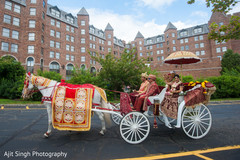 Indian bride and groom riding a carriage