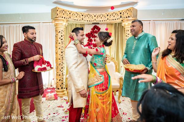 Maharani putting the garland to rajah.