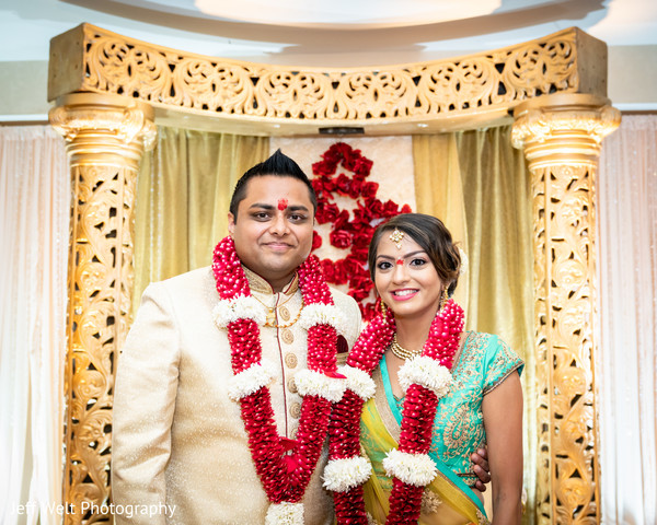 Marvelous portrait of Indian bride and groom at ceremony.