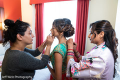Lovely Indian bride getting her makeup done.
