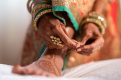 Maharani putting her anklets on.
