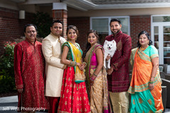 Indian couple with relatives photo.