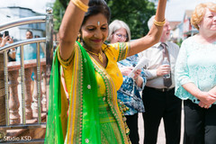 Beautiful guest having a great time during baraat