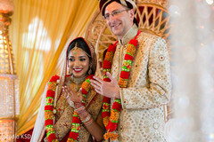 Dazzling Indian bride and groom at their wedding.