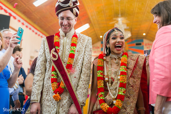 Joyful Indian couple at their ceremony