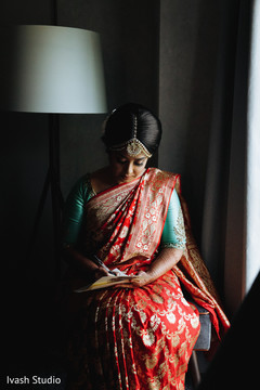 Lovely Indian bride writing her vows.
