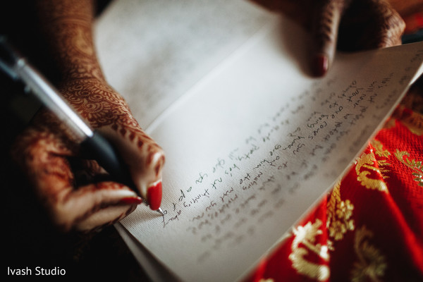 Closeup capture of Indian bride writing her vows.