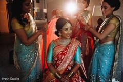 Indian bride getting her wedding veil on.