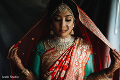 Glamorous Indian bride on her wedding ceremony outfit.