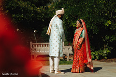 Sweet and lovely Indian bride and groom's first look scene.