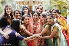 Joyful Indian bride with bridesmaids capture.
