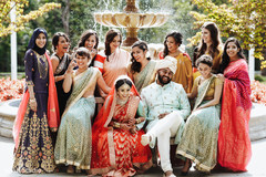 Indian couple with bridesmaids outdoors photo.
