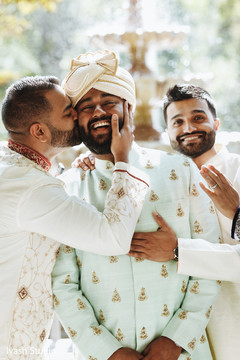 Charming Indian groom with  groomsmen capture.