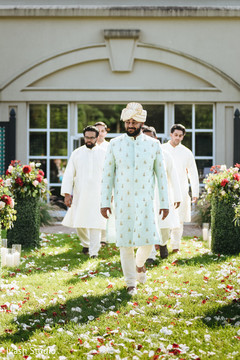 Charming Indian groom entrance to ceremony capture.