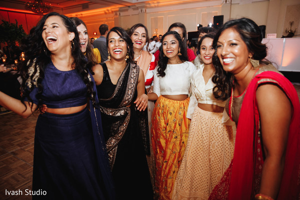 Joyful Indian bridesmaid at reception party.