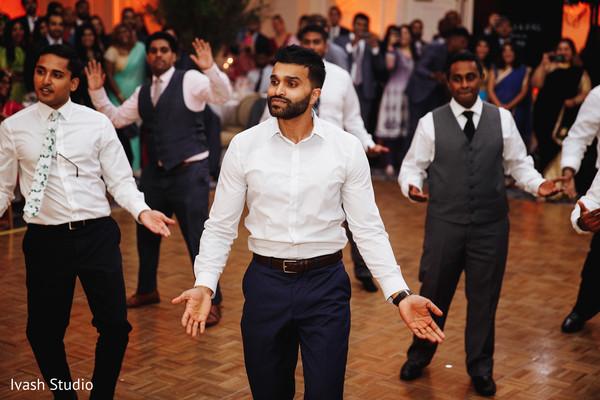 Indian groomsmen at reception dance choreography.
