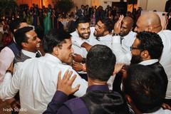 Upbeat Indian wedding reception party capture.