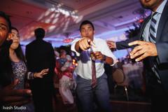 Fun capture of Indian wedding reception celebration.