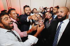 Indian groom and groomsmen making a toast.