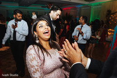 Joyful indian bridesmaid showing some dance moves