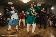 Indian groom and groomsmen sangeet dance photo.