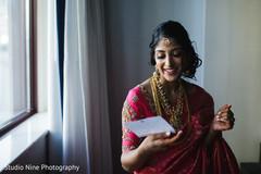 Maharani reading rajah's note.