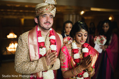 Marvelous Indian bride and groom at ceremony photo.