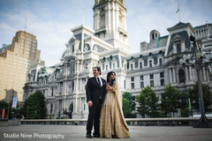 Stunning Indian bride and groom outdoors capture.