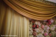Closeup capture of draping and flowers decoration of mandap.