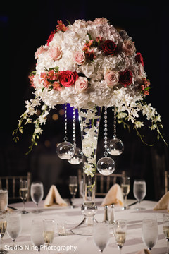 Magnificent Indian wedding table centerpiece flowers decor.