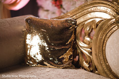 Elegant Indian wedding golden couch pillow.