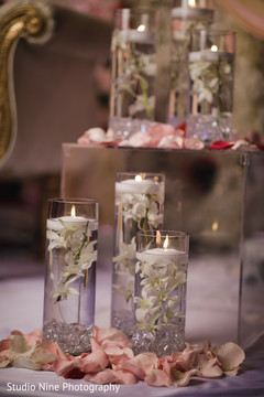 Dreamy Indian wedding candle and flowers decor.