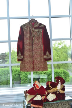Magnificent Indian groom's sherwani and accessories for ceremony.