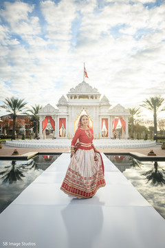 Indian bride glowing in her wedding attire.