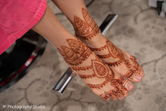 Wonderful Indian bridal mehndi art on her feet.