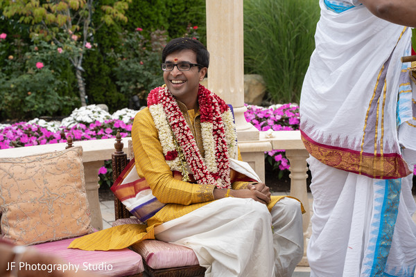 Charming Indian groom at his ceremony capture.